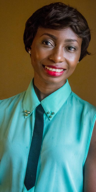 Smiling woman with short hair and green blouse